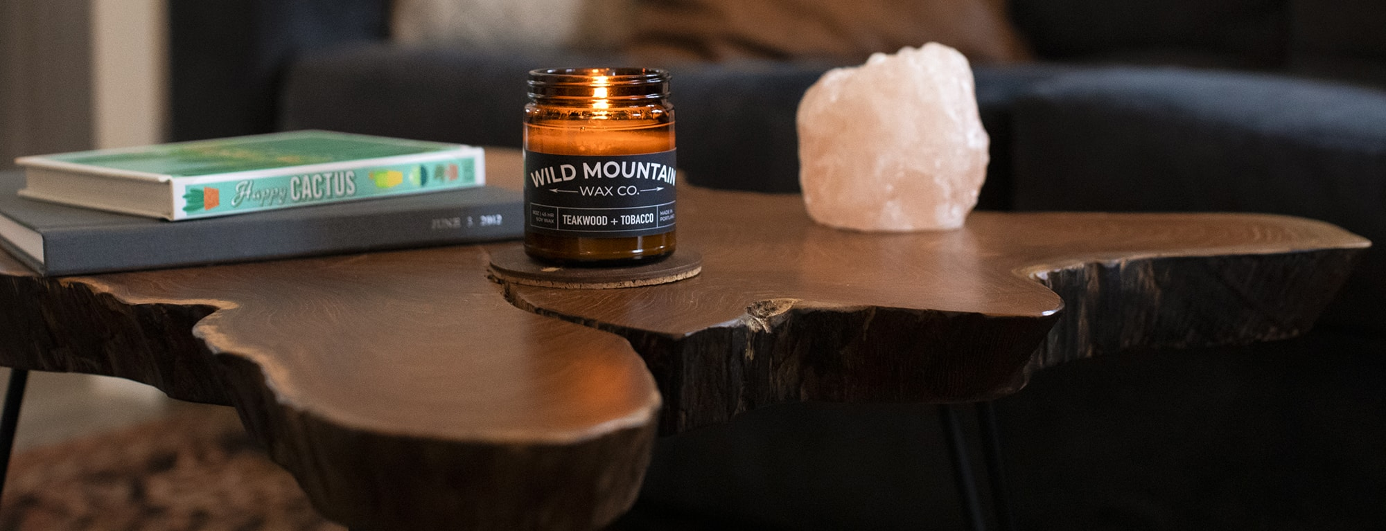 candle sitting on a wooden table